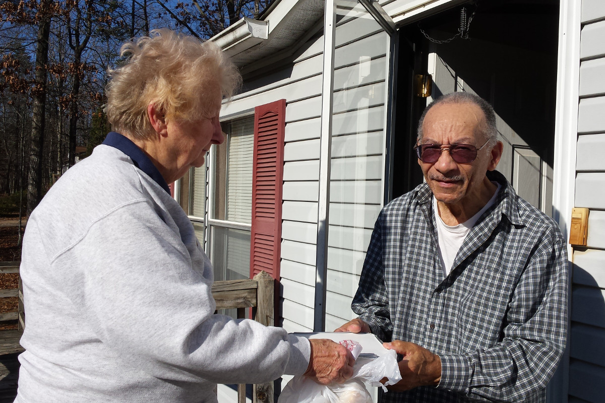 delivering a meal to an elderly man